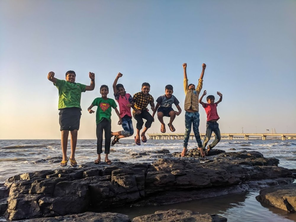 boys-jumping-for-joy-beach